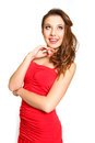Fashion young woman in a red dress posing isolated on white Royalty Free Stock Images