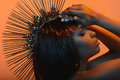 Fashionable african american woman in headpiece with hands on head Royalty Free Stock Photo