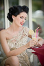 Fashionable attractive young woman in lace dress sitting in restaurant beyond the windows beautiful brunette posing elegant Royalty Free Stock Photography
