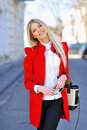 Fashionable attractive yuong woman in red dress with bag Royalty Free Stock Photo