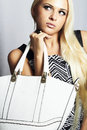 Fashionable beautiful blond woman with with handbag shopping portrait of Stock Photos