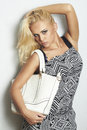 Fashionable beautiful blond woman with with handbag. shopping Royalty Free Stock Photo