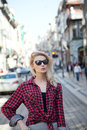 Fashionable blonde girl posing young beautiful woman walking on street Stock Image