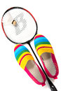 Fashionable bright easy sports shoes gym shoes with a racket and flounce for badminton on the isolated background Stock Photos