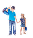 Fashionable children holding hands and shopping bags Royalty Free Stock Image