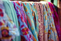 Fashionable clothes on pegs in a cloak room Royalty Free Stock Photo