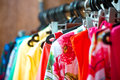 Fashionable clothes on pegs in a cloak room Stock Images