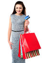 Fashionable female with shopping bags young woman holding and credit card Royalty Free Stock Image