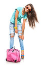 Fashionable girl happy young in stylish jeans and sunglasses posing against white background Stock Photography