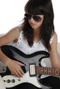 Fashionable girl playing electric guitar Stock Images