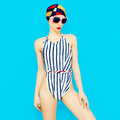 Fashionable girl in vintage swimsuit.