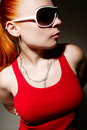 Fashionable hip-hop girl posing in studio Royalty Free Stock Photo