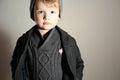 Fashionable Little Boy in Cap. Stylish Kid. Fashion Children. Handsome blond kid. Winter Style. Warm Coat. Icon Royalty Free Stock Photo