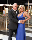 Fashionable middle aged couple Royalty Free Stock Images