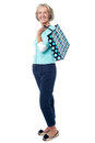 Fashionable old lady with shopping bag Royalty Free Stock Photo