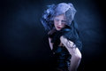 Fashionable sad woman cold young widow wonam with feathered hat Royalty Free Stock Photos