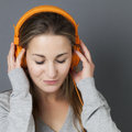 Fashionable sound for gorgeous relaxed female teenager Royalty Free Stock Photo