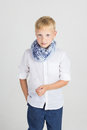Fashionable teenager boy in blue scarf Royalty Free Stock Photo