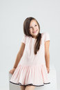 Fashionable teenager girl in pink dress smiles Royalty Free Stock Photo