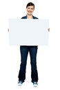 Fashionable trendy woman holding blank ad board Royalty Free Stock Images