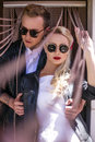 Fashionable wedding couple. Bride and Groom. Outdoor portrait Royalty Free Stock Photo