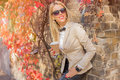 Fashionable woman leaning against the wall Royalty Free Stock Photo