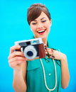 Fashionable woman looking at old fashioned camera Stock Photos