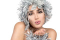 Fashionable woman portrait with silver stylism vogue style mode beauty christmas girl sensual lips and festive makeup over white Stock Photography