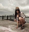 Fashionable woman squatting Royalty Free Stock Photography