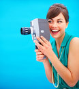 Fashionable woman using an old fashioned camera Royalty Free Stock Image