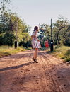 Fashionable women in countryside two woman on dirt track Royalty Free Stock Photos