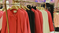 Fashionable women dress on hangers in clothing shop Royalty Free Stock Photo