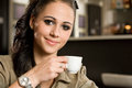 Fashionable young brunette woman having coffee. Stock Photo
