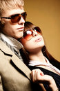 Fashionable young couple wearing sunglasses Stock Photos