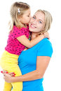 Fashionable young kid kissing her mother Stock Photography