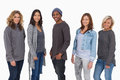 Fashionable young people in a line smiling on white background Royalty Free Stock Photography