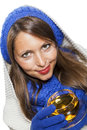 Fashionable young woman in a blue knitted winter ensemble and cowl neck jersey sipping cup of hot tea with smile an effort Stock Photos