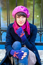 Fashionable young woman wearing pink beret scarf and blue gloves Royalty Free Stock Images