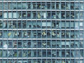 Fassade of offices frontal view a glazed office building facade Royalty Free Stock Images