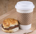 Fast breakfast a of biscuits sausage and coffee Stock Images