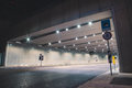Fast cars in a modern tunnel by night Royalty Free Stock Photo