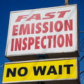 Fast emission inspection sign advertising inspections Royalty Free Stock Image