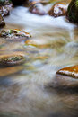 Fast flowing water in the mountain river for adv or others purpose use Royalty Free Stock Photos
