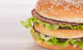 Fast food big hamburger on the wood background Stock Photos