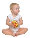 Fast food concept. Infant child baby toddler hold tasty unhealth Royalty Free Stock Photo