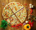 Fast food, delicious hot Italian pizza with vegetables Royalty Free Stock Photo