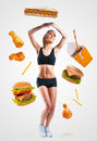 Fast food falling on a young woman Royalty Free Stock Photo