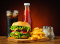 Fast food hamburger menu still life with french fries soft drink and ketchup Stock Photography