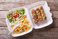 Fast food: kebabs, fries and fresh salad in the tray. horizontal Royalty Free Stock Photo