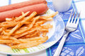 Fast food - Potatoes and frankfurters Royalty Free Stock Image